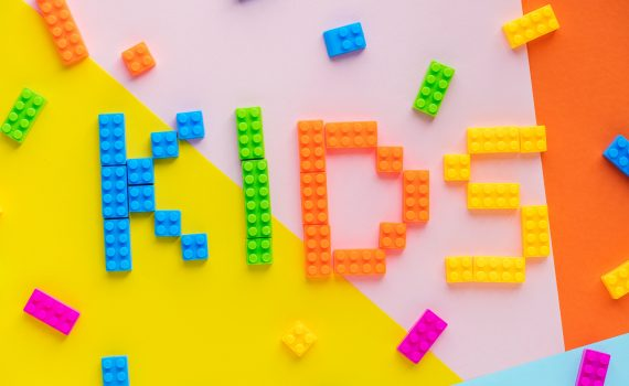 "word ""kids"" written with Lego blocks"